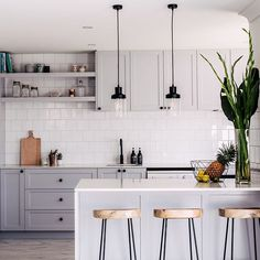 Grey kitchen, white tiles, black accents