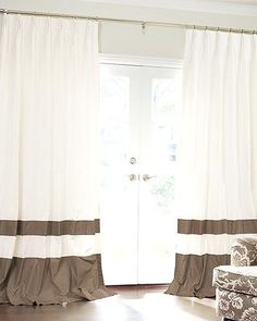 I like the colorblock style to the curtains, for the sunroom. But I'd rather go with a graduation of a color I think...