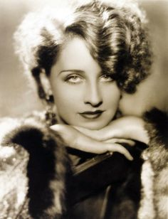 Norma Shearer.  Her hair is great in this picture.
