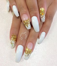 A white french tip isn't bad. But since it's a coffin nail, the tip would be wider. So how about adding gold rhinestones for added glam?