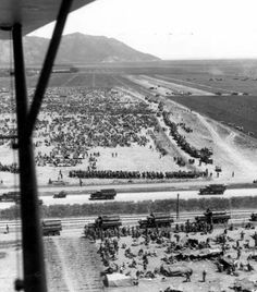 Allied troops took 252,415 prisoners, together with large quantities of equipment and supplies, when the enemy surrendered in Tunisia on 13 May 1943. Because of Allied air and naval superiority the enemy was unable to evacuate his troops. This photo shows German prisoners in a holding camp near Mateur, Tunisia, with US CCKW trucks and other vehicles visible.