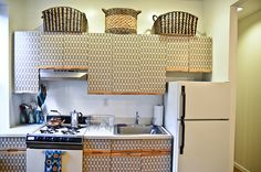 4 DIY Tips to Tame Your Tiny Kitchen by Kim Myles: Contact Papered Cabinet Doors