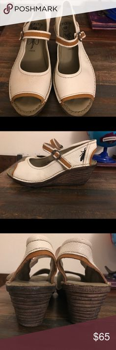 FLY London white wedge. Have been warn with love. Size 9. Velcro. Fly London Shoes Wedges