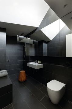 """The bathroom is intentionally """"a bit of a cave,"""" with only diffused southern light from above."""