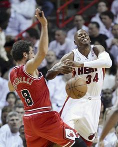 The Heat's Ray Allen is fouled by Marco Belinelli in the first half. — John J. Kim, Chicago Tribune, May 8, 2013