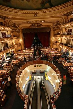 El Ateneo bookstore - Buenos Aires, Argentina...with built in slides to go downstairs