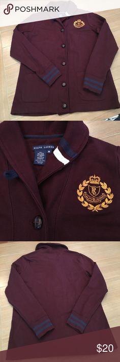 Maroon Ralph Lauren Sweater Blazer Sz M Maroon Sweater Blazer by Ralph Lauren. High Collar with navy and white stripe. Brown leather buttons and two pockets. Ralph Lauren Embroidered emblem on left side of chest. Worn and washed with tide. Hung dry. Signs of wear shown. Bundle and save! Ralph Lauren Jackets & Coats Blazers