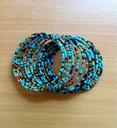 Handmade beaded bracelet blue black red by YouthEducationKenya - 100% of sales go directly back to this incredible organization!