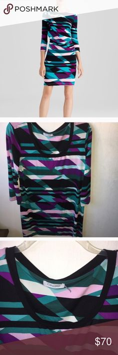 Calvin Klein Retro Coaktail Dress Size Large Calvin Klein Retro Coaktail Dress Size Large, stretchy material, wide Sleeves. Size fell off but this is a large. Love the retro geometric shape print. Retail $165. Calvin Klein Dresses