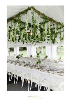 Stunning marquee reception with stunning floral arbour all by First Class Functions