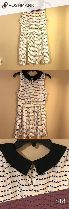 Black and White Collared Dress White dress with black triangle print, black collar. Never worn. No stretch material. Size medium. Dresses