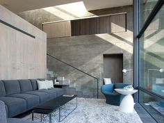 Concrete retainer walls anchor the house to the hillside, integrating the house into the surrounding slope. SMALL HOUSE : ELLIOT KAUFMAN