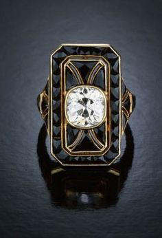 Art Deco onyx & diamond ring. I am not usually an onyx lover, but this is really beautiful! #OnyxRingsJewels