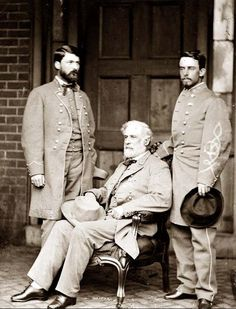 General Robert E. Lee with son George Washington Custis Lee on his right and aide Walter Taylor on his left.
