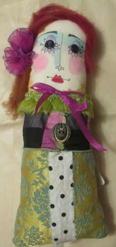 Dot.14.5 x 56 fabric rag doll with wool hair. Not a toy.. $27.00, via Etsy.