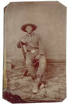 Tintype of a Cowboy and His Revolver, - Cowan's Auctions.