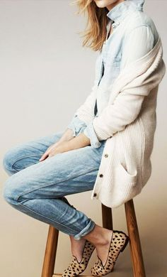 A denim button-up is worn with blue jeans, cheetah print flats and a cream cardigan.