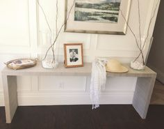 This DIY project. Can you believe it's an Ikea Malm occasional table covered in grasscloth wallpaper?