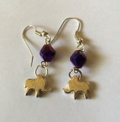 A personal favorite from my Etsy shop https://www.etsy.com/listing/556933543/elephant-walk-dangle-earrings-with-blue