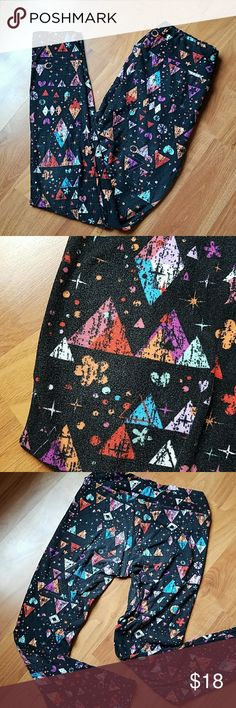 """Lularoe One Size leggings These were referred to as """"Lucky Charms"""" print. They have some fading on the booty and knee areas as shown in the pictures but that never stopped me from wearing them! They are i n good condition I just need to pair down my stash! :D LuLaRoe Pants Leggings"""