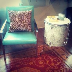 Drum side table!  aqua chair and leopard