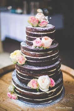 rustic naked wedding cake with pink roses / http://www.deerpearlflowers.com/rustic-wedding-details-and-ideas/2/