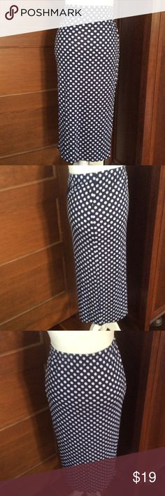 Navy blue and white stretch pencil skirt Stretch pencil skirt in navy blue and white polka dots.  Measures 30 inches long and 20 inches across the hips before it begins to stretch. Fabric is 95% rayon and 5% spandex Reborn Skirts Midi