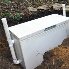 Off the Grid Living - Burying a freezer to use as a make-do root cellar.