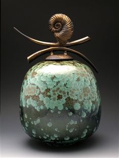 Debra Steide. Our world has become over saturated with machine made production items. Fine crafted works of art are becoming a rarity. (not really glass but very beautiful)