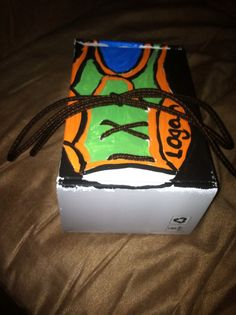 Tool to help teach your child how to tie their shoe.  Just a box I painted to look like a shoe and laced up. CGH. -  it took Logan 5 minutes to learn to tie his shoe!