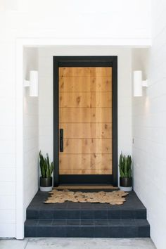 Crisp white walls and chic black trim extend throughout this California ranch house from PRAIRIE Interior Design. Inside, woven accents and eclectic furnishings add unexpected warmth, color and character to the modern interior. Modern Front Door, Wood Front Doors, Painted Front Doors, The Doors, Entry Doors, Entrance, Front Door Paint Colors, Front Door Design, Modern Ranch