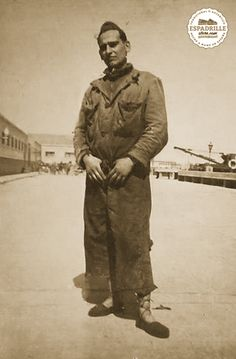 Young soldier posing nonchalantly for the camera, wearing his laced espadrilles