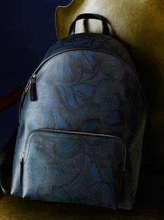 ea9877bc2142 A Burberry leather-trimmed floral printed London check backpack features  smooth lines and zip pockets