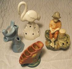 Figural Flower Frogs. Not only for arrainging your flowers they are great for holding pens and pencils.