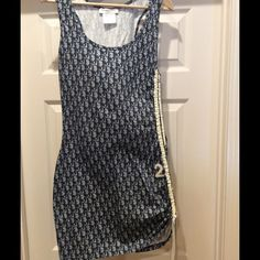 Stunning Dior Tank Dress This dress is gorgeous with the Dior logo cotton fabric. I've not worn it but did remove the tag. It runs small. Fits like an 8. Dior Dresses
