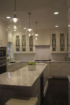 Marble Countertops, herringbone backsplash, Des Moines Iowa remodel, www.TheStoneShop.com