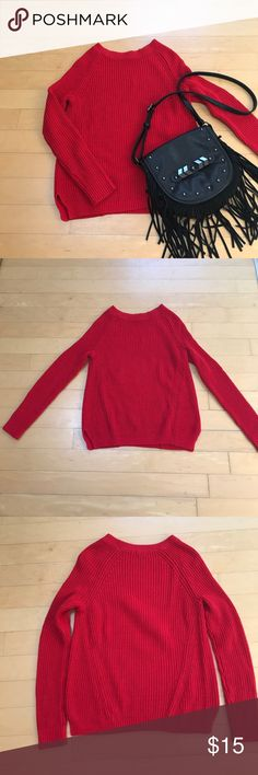 """Red Chunky Sweater I love this cozy sweater over a pair of leggings with boots. The ultimate in comfort. Bright red cotton/acrylic blend adds a pop of color to dreary days. Diagonal weave in the back helps give the sweater a shape for a more flattering fit. Side slits for a nice fit over hips. Preloved, but well taken care of so it's still in great condition. No holes, pulls or pills. 25"""" long and 18"""" across bust with stretch. Express Sweaters Crew & Scoop Necks"""