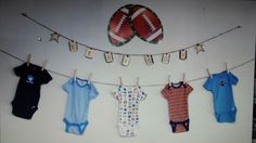 Baby shower decor ideas Onesies hanging on a clothes line.