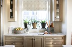 Suzie: Urban Grace Interiors - Lovely taupe kitchen design with taupe kitchen cabinets, stone ...