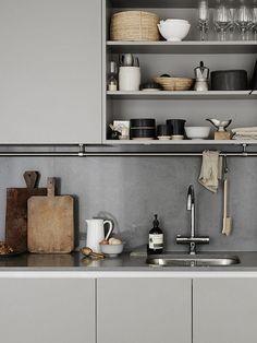 Grey kitchen in a Stockholm pad with a mix of vintage  and  designer pieces. Kristofer Johnsson / Josefin Hååg. Residence.: