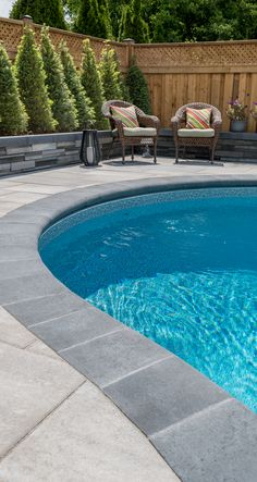 The Spherik is a bullnose shaped paver created as a slip-resistant, rounded-edge surface for contours of in-ground pools. Throughout the years, this paver has taken on many other applications such as coping for retaining walls or steps. Backyard Pool Designs, Swimming Pools Backyard, Swimming Pool Designs, Swimming Pool Tiles, Pool Pavers, Concrete Pool, Stamped Concrete, Pool Coping, Landscaping Around Pool