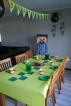 Minecraft party, grass block cake. A banner with a Downloaded Monecraft font, cut out with the Silhouette Cameo
