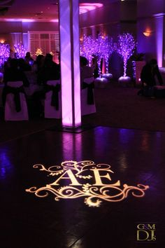 Wedding Monogram, Towers and Purple Uplighting @HillstoneStL | G&M DJs | Magnifique Wedding Lighting #gmdjs #magnifiqueweddings #custommongram @gmdjs