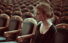 She sat in the empty auditorium. Hoping that if she listened loud enough, she would hear him sing...
