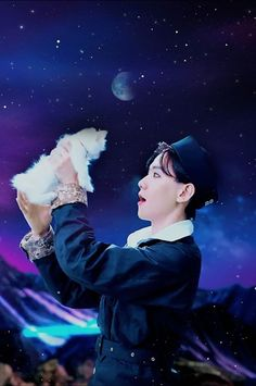 Baekhyun holding a white fluffy cat has been the best thing i have seen all day