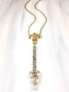 """""""Her Wanderings"""" - 1940's rhinestone drops paired with antique brass scroll medallion on pyrite beaded chain"""