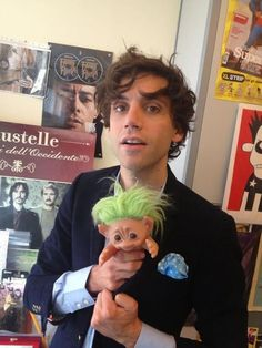Mika at La Repubblica XL 2012, with a troll doll xD