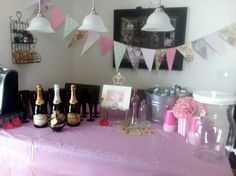 """""""Drink Me"""" station for party beverages, including non-alcoholic punch, water, champagne with raspberries and chambord, and of course, tea! The flag banner was made with scrapbook paper in various patterns to match the party decor."""