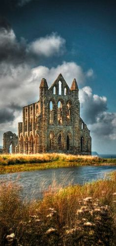 Whitby Abbey, a ruined Benedictine Abbey overlooking North Sea on the East Cliff Above Whitby in North Yorkshire, England. It was disestablished during the Dissolution of the Monasteries under the auspices of Henry VIII. Yorkshire England, North Yorkshire, Whitby England, England Uk, The Places Youll Go, Places To See, Beautiful Buildings, Beautiful Places, Dissolution Of The Monasteries