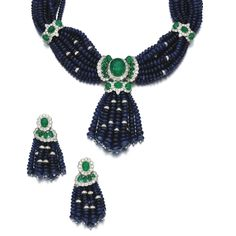 Sapphire, emerald and diamond demi-parure, Andreoli Comprising: a necklace and pair of earrings, each designed as lines of polished sapphire beads connected by clusters set with cabochon emeralds and brilliant-cut diamonds, the necklace accented with diamond rondelles and suspending a detachable tassel pendant; necklace length approximately 415mm, unsigned, earrings with collapsible post and hinged back fittings, signed Andreoli.